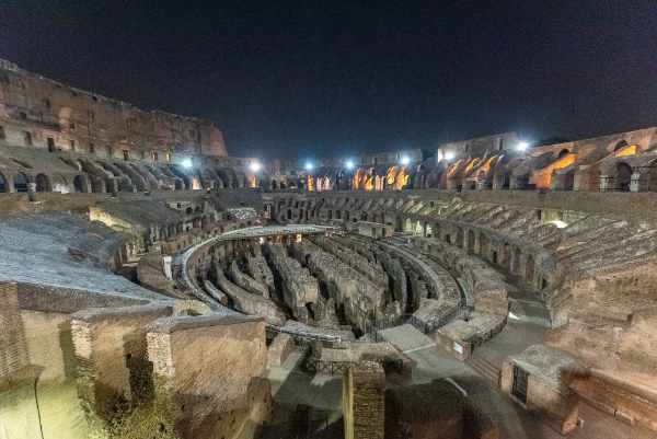 Your guided night tour begins at the Colosseum Arena entering through the restricted Gladiator's Gate, you will view this colossal structure from an impressive vantage point.