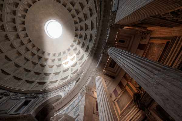 Admire one of the most magnificent sights of Rome – the <b>Pantheon</b>. An extraordinary structure with an equally unique history, the <b>Pantheon</b> is one of the best preserved of all the Ancient Roman buildings. And two thousand years after being built, it is still the world's largest unreinforced concrete dome standing.