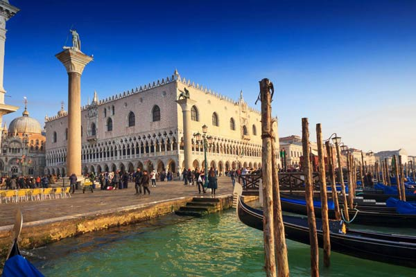 Skip the line Doge's Palace Tour – Visit the courtyard, loggias of this Venetian Gothic-style palace built in 1340. The elaborate Giant's Staircases (Scala dei Giganti) with the colossal statues of Mars and Neptune by Jacopo Sansovino on either side signifying Venice's power over land and sea.